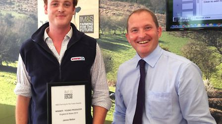 James Mellor, left, receives his award from Steve Mclean, M&S head of agriculture and fisheries.