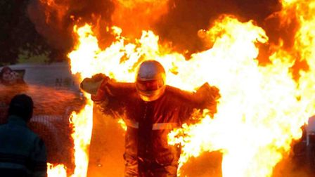 A burning man entertains the crowds at The Extreme Stunt Show in Moor Park, Preston. Picture: DAVID