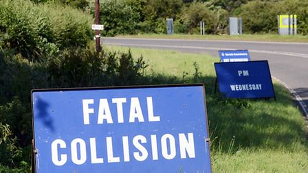 Police sign on the side of the road at Hilborough, the scene of a fatal crash on July 2. Picture: Ma