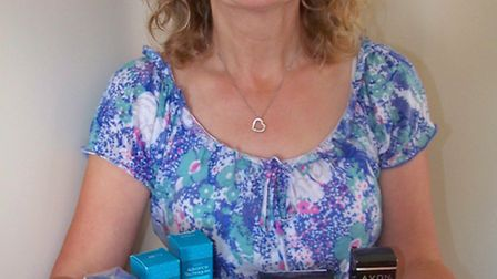 Mary Downey with Avon products