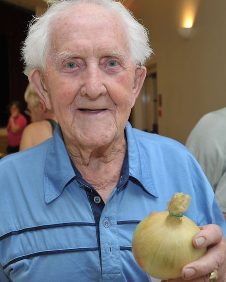 Doddington Horticultural Show. 91 year old Albert Short with his onion.Picture: Steve Williams.