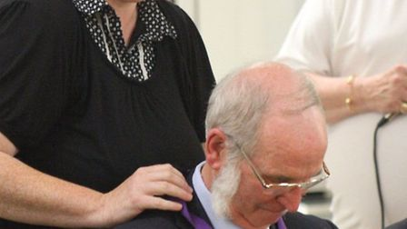Kevin Rodgerss chain was placed around his neck (backwards) by his daughter Mrs Claire Storey of Wim
