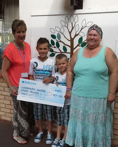 Woodlands lead nurse Lynda Hall receives a cheque from (from left) Riley and Keaton Astley and their