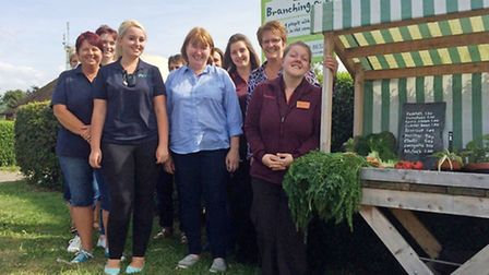 Colleagues and store manager, Karen Watts, from Sainsbury's Ely with team members and Branching Out