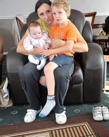 March Floods Aftermath. Amy Cosford with children Katie-May and Jake Furnell with their wet carpets.