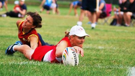 Kellie James scoring a touch-down
