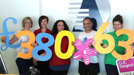 Event organisers celebrate the fund-raising total.