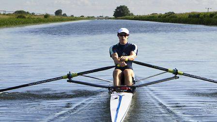 John Hale pictured in his single scull just beyond Queen Adelaide Bridge.