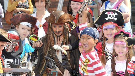 Pirates Day at the Horsefair shopping center Wisbech. Captain Jack Sparrow with some of the children