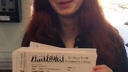 A Harry Smith pupil shows off her results.