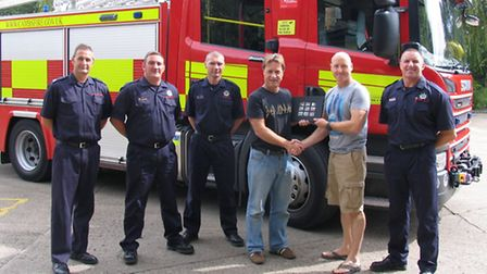 Fellow firefighters say goodbye to Adrian Moore (third from right).
