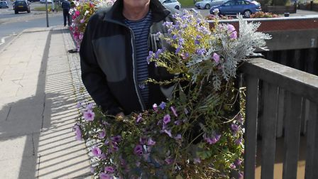Brian Massingham, chairman of Wisbech in Bloom, inspects the damage