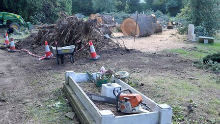 Clearing fallen tree at Station Road Cemetery March. Picture: Steve Williams.