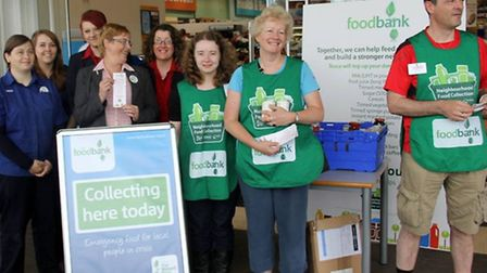 Members of the March Foodbank and Tesco staff at the food collection.