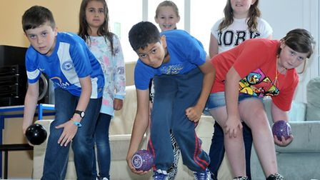 Introducing bowls to youngsters at the Young People March Centre. Left: Mathew,Yagmur,Jake,Cassie, I