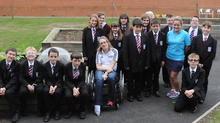Fran Williamson with staff and pupils at Cromwell Community College