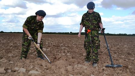 Corporal Whisker and Cadet Sharp learning the art of metal detection as part of a Great War project