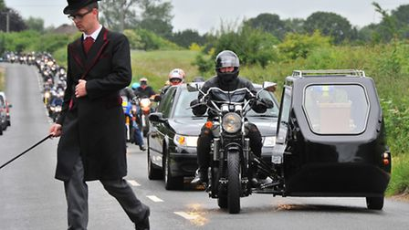 A motorcycle hearse carrying David Holmes, who died in a motorcycle crash on the A47, arrives at his