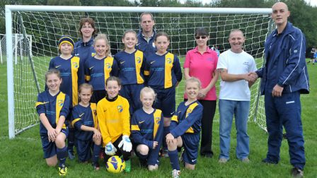 Kit presentation for Estover Park Under-12 girls by sponsor M&W Cermaics. Right: Tracy and Mick Tann