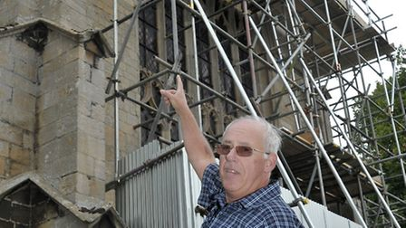 Dr Charles Nelson showing the scaffolding now covering part of St Clement's Church, Outwell. Picture