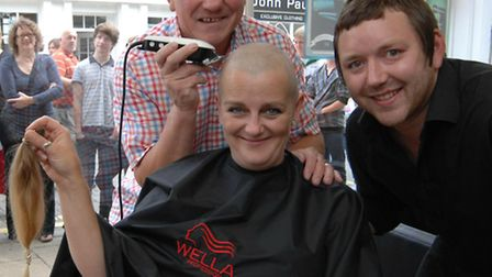 David Green, right, pictured last year with Dave Green and Donna Bright during a charity head shave.