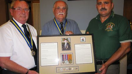 Medals presented to Eric Deuters