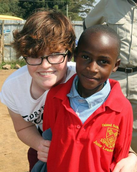 Poppy Mifsud, with a young boy from Basura Primary School
