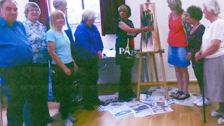 Some of the March Art Group members with artist Glyn Plumb at a workshop on Thursday.