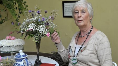 Flower festival at Peckover House, Wisbech. Volunteer Wendy Smith with one of the display's. Picture