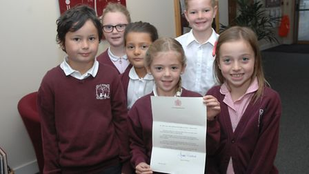 From left, Logan, Hannah, Katie, Alex, Findlay and Nieve with the letter from the Queen.