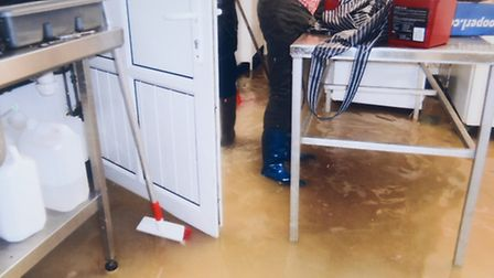 Collect photos of the flood waters in Spikings Butchers on St Peters in Upwell. Picture: Submitted.
