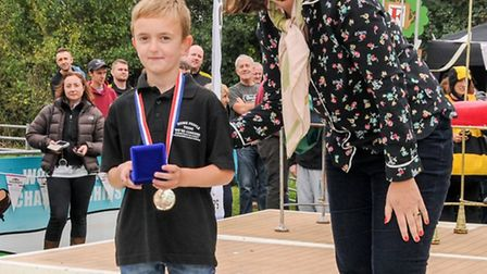 Elliott Hurrell is presented with his golfd medal at the World Conker Championships.