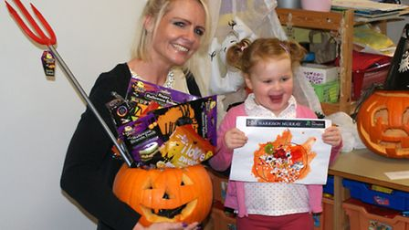 Harrison Murray sales manager from the March branch, Nicola Roberts, presents the Halloween themed p