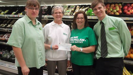 Bec Steward presenting the cheque to Gill Smith, chairman of the March, Chatteris and District Commi
