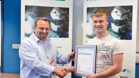 Colin Kennedy, of Skillweld, presents James Simpson his certificate.