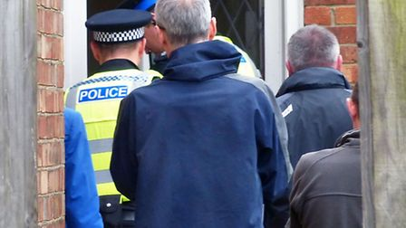 Officers entering the house in Colvile Road, Wisbech, last May as part of Operation Pheasant.