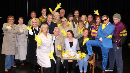 The cast of Acorn Antiques wearing the infamous marigold gloves.