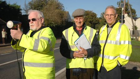 Speed watch members Barry Hayes and Brian Hanney, with Councillor Vic Ranger.