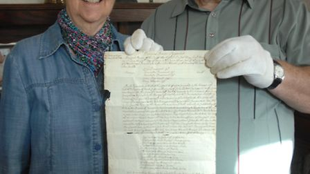 Pat and Steve Schorah with the 300-year-old letter