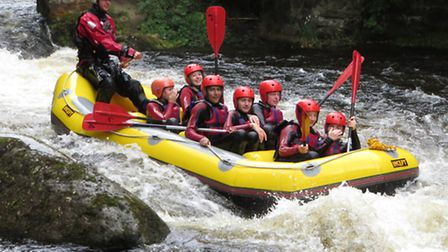 Students white-water rafting.