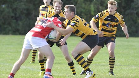 Ely Tigers' John Dibb tackles his opponent.