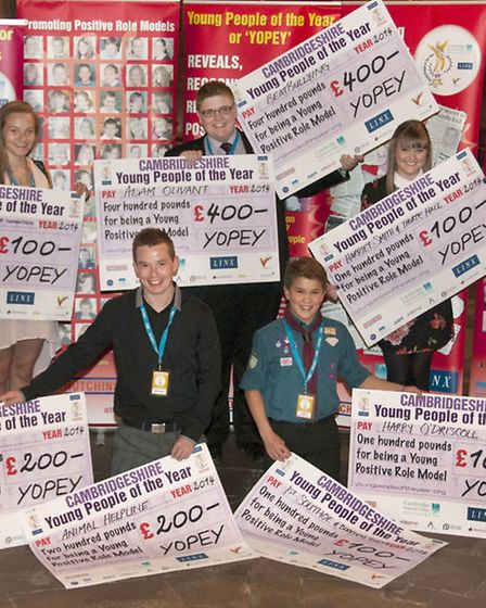 The five main winners with their cheques.
