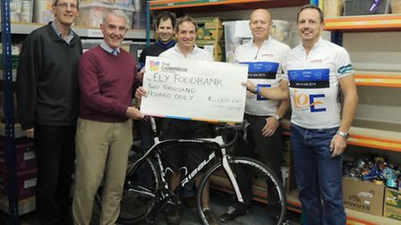 Karl Relton and Alan Williams from Ely Food Bank, Octagon Cycling Club members Pat Abbott, Ian Smith