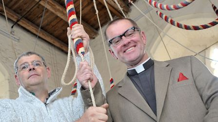 St Peter and St Pauls church in Wisbech, Left: Tower Captain David Appleby and Father Paul West with