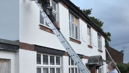 Electronic and security technician Martin Fenn installing CCTV at Wadyingstow House with help from h