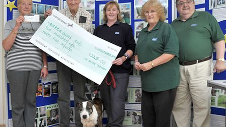Cheque presentation at RSPCA Block Fen. Left: Becky Hoy raised £100 from penny collections at the Br