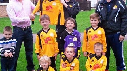March Town United FC under 7s Red team are presented with their kits by Steve Clarke of EMR Wall Coa