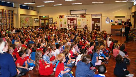 Pupils listen intently at Red, White and Blue Day.
