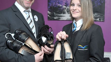 Tesco store Manager Kevin Chestnutt handing over new shoes to Tia Mason. Picture: Steve Williams.