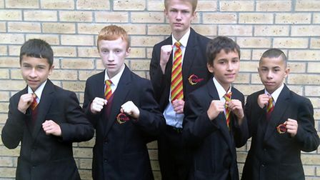 Kacper Ciureja, second right, and Igor Mihailov, centre, with fellow Sparta ABC March boxers, from l